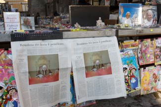 Copies of the February 11 Italian edition of the Vatican's L'Osservatore Romano newspaper on a news stand near the Vatican. (CNS photo/Paul Haring)