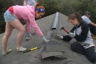 University students work on Habitat for Humanity home during SpringBreak.(CNS photo/courtesy Sacred Heart University)