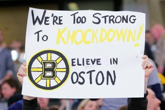 A fan holds a sign during a Boston Bruins hockey game after the marathon bombings. (CNS photo/Jessica Rinaldi, Reuters)