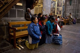People attend Mass in the Quechua language at the Cathedral of Santo Domingo in Cusco, Peru. (CNS photo/Elie Gardner)