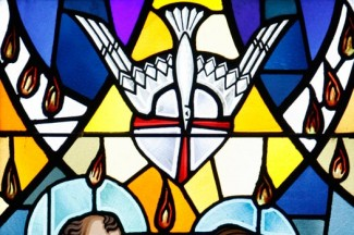 A scene from Pentecost is depicted in a stained-glass window at St. Francis of Assisi Church in Greenlawn, New York. (CNS photo/Gregory A. Shemitz, Long Island Catholic)