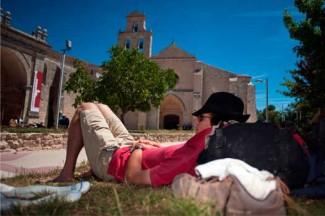 A Camino pilgrim rests in Burgos, Spain. (CNS photo/Felix Ordonez, Reuters)