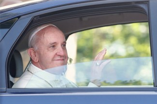 Pope Francis waves from a car during his visit to Castel Gandolfo, Italy. (CNS photo/Tony Gentile, Reuters).