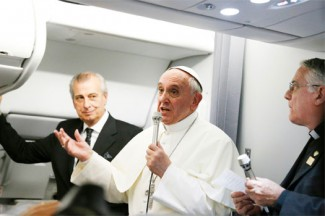 Pope Francis addresses journalists on his return flight from Rio de Janeiro to Rome. (CNS photo/Paul Haring)