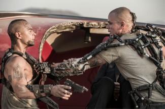 "Jose Pablo Cantillo and Matt Damon star in a scene from the movie ""Elysium."" (CNS photo/Sony)"
