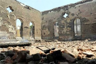 A destroyed Protestant church is seen in Mallawi, Egypt, August 17. (CNS photo/Reuters)