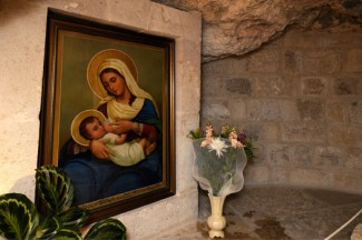 A painting of Mary breast feeding the infant Jesus is seen at the Milk Grotto chapel in Bethlehem. (CNS photo/Debbie Hill)
