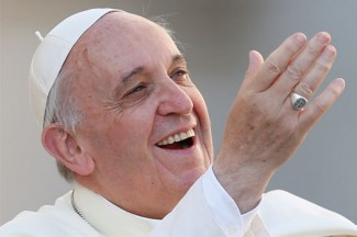 Pope Francis greets the crowd as he arrives for the general audience in St. Peter's Square. (CNS photo/Paul Haring)