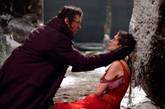 Hugh Jackman, as Jean Valjean, and Anne Hathaway, as Fantine, in Les Miserables.