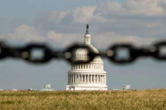 U.S. Capitol is photographed behind a chain fence in Washington. (CNS photo/Kevin Lamarque, Reuters)