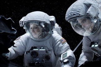 "Sandra Bullock and George Clooney star in a scene from the movie ""Gravity."" (CNS photo/Warner Bros.)"