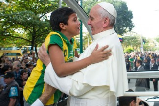 Pope Francis embraces a boy at World Youth Day in Rio de Janeiro, Brazil. (CNS photo/L'Osservatore Romano)