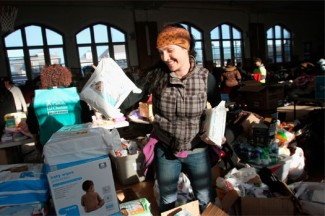 Volunteer organizes items at a relief center for those affected by Hurricane Sandy last fall. (CNS photo/Gregory A. Shemitz)
