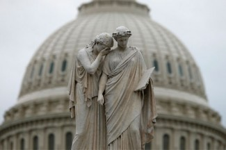 The statue of Grief and History stands near the U.S. Capitol dome in Washington. (CNS photo/ Kevin Lamarque, Reuters)