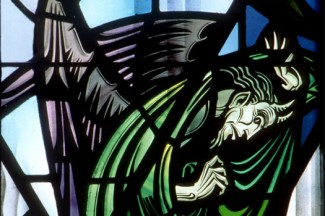 The devil is portrayed in this stained-glass church window. (CNS photo from Crosiers)