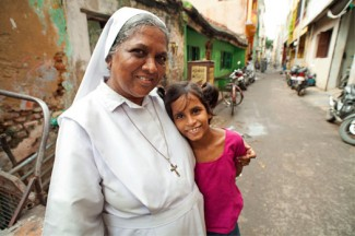 Sister Clara and a girl in India. Sister Clara's mission work is supported by gifts from World Mission Sunday.