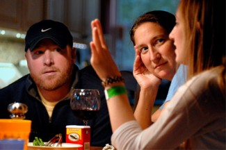 Parents listen to their daughter during dinner in the family's home. (CNS photo illustration/Sid Hastings)