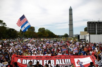 Hundreds of protesters calling for comprehensive immigration reform gather at a rally on the Washington Mall October 8. (CNS photo/Jason Reed, Reuters)