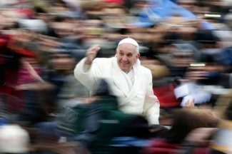 Pope Francis waves as he arrives for his weekly audience in St. Peter's Square at Vatican. (CNS photo/Max Rossi, Reuters)
