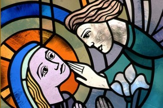 A window at St. Marys' Church in Willmar, Minnesota, depicting the Annunciation. (CNS photo from Crosiers)