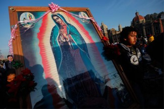 A pilgrim carries an image of Our Lady of Guadalupe during celebrations marking her feast day in Mexico City. (CNS photo/Edgard Garrido, Reuters)