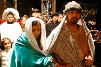 People dressed as Mary and Joseph walk down a Chicago street during a celebration of Las Posadas. (CNS/Karen Callaway, Catholic New World)