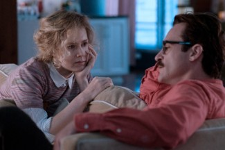 "Amy Adams and Joaquin Phoenix star in the movie ""Her."" (CNS photo/Warner Bros.)"