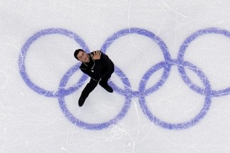 Evan Lysacek of the United States performs during the men's free skating competition at the Vancouver 2010 Winter Olympics. (CNS photo/Lucy Nicholson, Reuters)