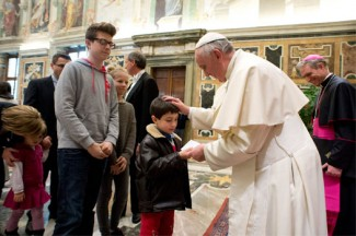 Pope Francis blesses a child during a meeting with members of the Italian Federation of Spiritual Exercises at the Vatican. (CNS photo/L'Osservatore Romano via Reuters)