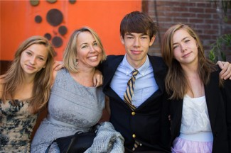 Mary Beth (second from left) and her three children. (Photo credit: Nylagray Photography)