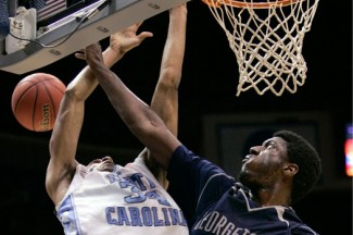 Georgetown basketball player blocks a shot during a regional final game in 2007. (CNS photo/Mike Segar, Reuters)