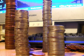 """Coin Stack 1"" image by Stephen Train licensed under Creative Commons ""Attribution 2.0"" https://www.flickr.com/photos/mrtea/"