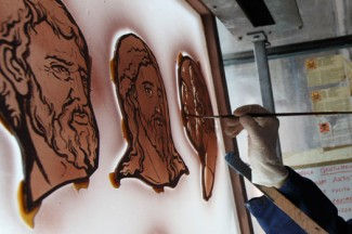 A woman works on art for a stained-glass window. (CNS photo/Paul Haring)