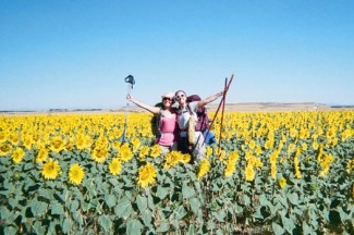 Maggie, left, standing in a field of sunflowers along the Camino de Santiago.