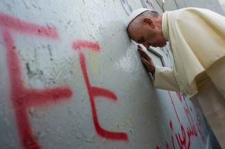 Pope Francis stops in front of an Israeli security wall in Bethlehem, West Bank, on his recent visit to Palestine. (CNS photo/L'Osservatore Romano, pool)