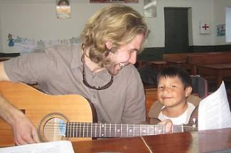 Brian and a little boy at a parish choir practice.