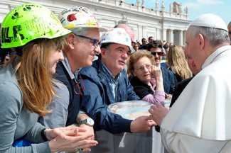 Pope Francis meets workers from aluminum company Alcoa during his general audience in St. Peter's Square at the Vatican. (CNS photo/L'Osservatore Romano via Reuters)