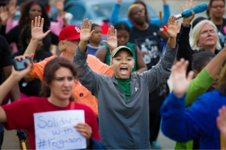 Protesters hold their hands in the air during a demonstration against the shooting death of Michael Brown in Ferguson, Missouri. (CNS photo/Lisa Johnston, St. Louis Review)