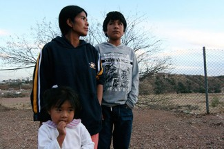 Leoba Marcos stands with her two children outside a church-run shelter for deportees in Nogales, Mexico. The shelter is part of the Kino Border Initiative. (J.D. Long-Garcia/Catholic Sun)