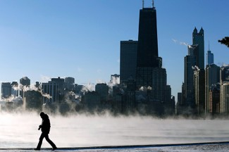 A man is silhouetted against the arctic smoke rising off Lake Michigan in Chicago. (CNS photo/Jim Young, Reuters)