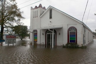 Floodwaters surround St. Paul Missionary Baptist Church after Tropical Storm Isaac swept through parts of Louisiana in 2012. (CNS photo/Sean Gardner, Reuters)