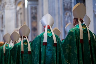 Bishops arrive in procession for a Mass celebrated by Pope Francis to open extraordinary Synod of Bishops on the family. (CNS photo/CNS photo/Maria Grazia Picciarella, pool)