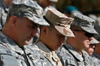 U.S. soldiers pray at a Veterans Day ceremony in Kabul, Afghanistan, in 2008. (CNS photo/Omar Sobhani, Reuters)