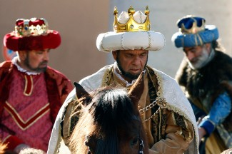 Men dressed as the Three Kings ride on horses in an Epiphany parade in St. Peter's Square at the Vatican. (CNS photo/Paul Haring)