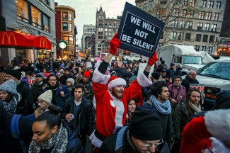 A man dressed as Santa Claus joins protesters in a march Dec. 13 in New York City calling for changes in the criminal justice system. (CNS photo/Eduardo Munoz, Reuters)