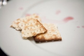 Matzo and drops of wine are seen on a plate at a Seder table.(Catholic News Service photo/Nancy Phelan Wiechec)