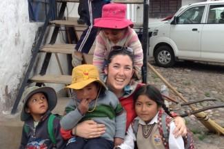 Jacqueline Shrader, center, a Jesuit Volunteer in Andahuaylillas, Peru.
