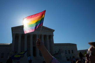 A supporter for same-sex marriage stands outside the U.S. Supreme Court. (CNS photo/Tyler Orsburn)