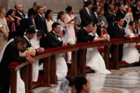 Newly married couples kneel as Pope Francis celebrates the marriage rite for 20 couples in St. Peter's Basilica. (CNS photo/Paul Haring)