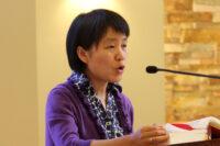 Sister Clara Zhang Jin Ping serves as a lector during Mass. (CNS photo/Gregory A. Shemitz)